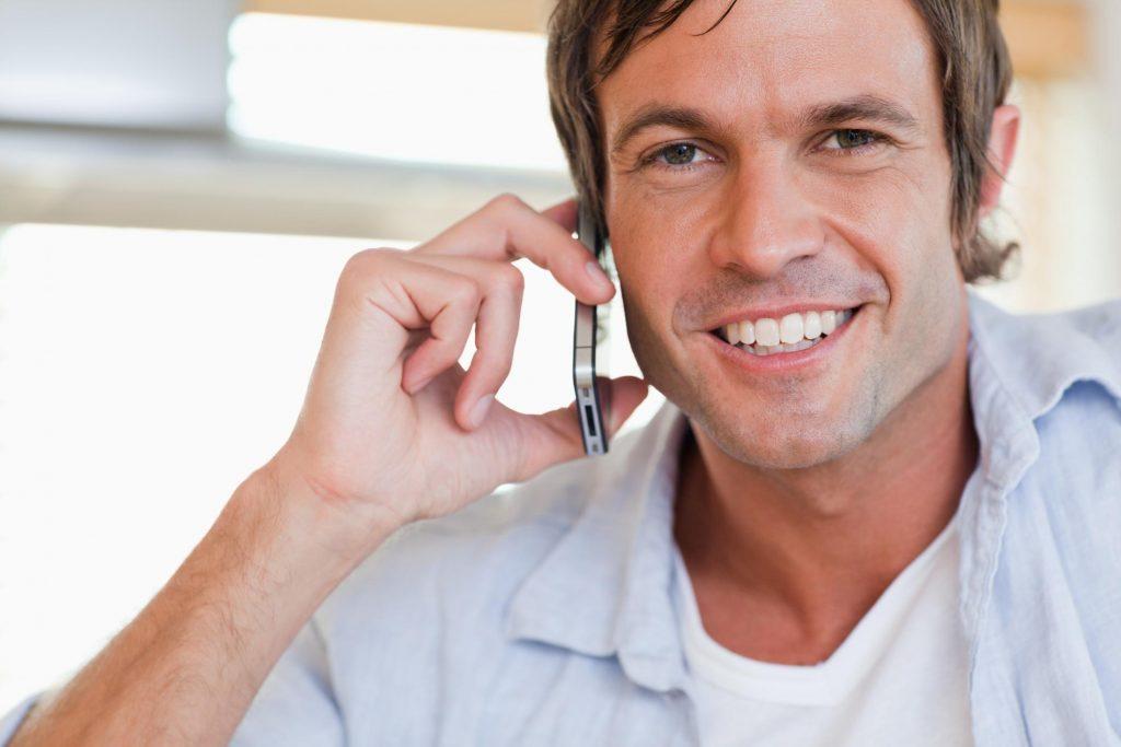 man using phone to call